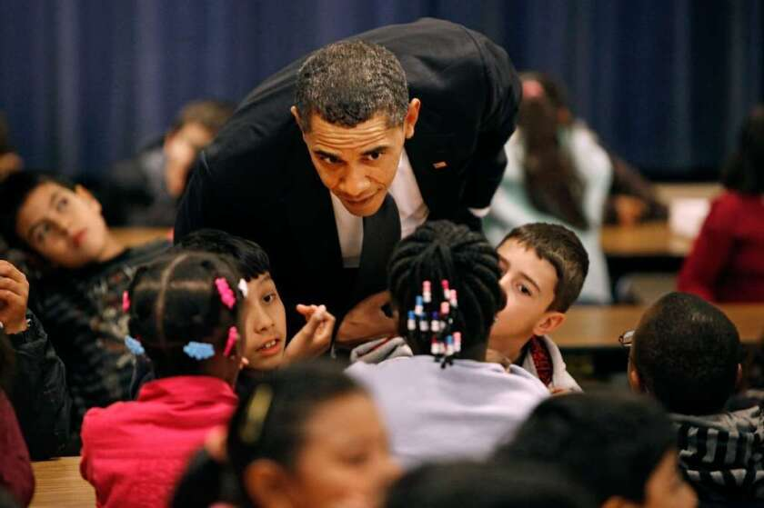 President Obama is seen visiting a school in Maryland. Congress is considering several education bills this year.