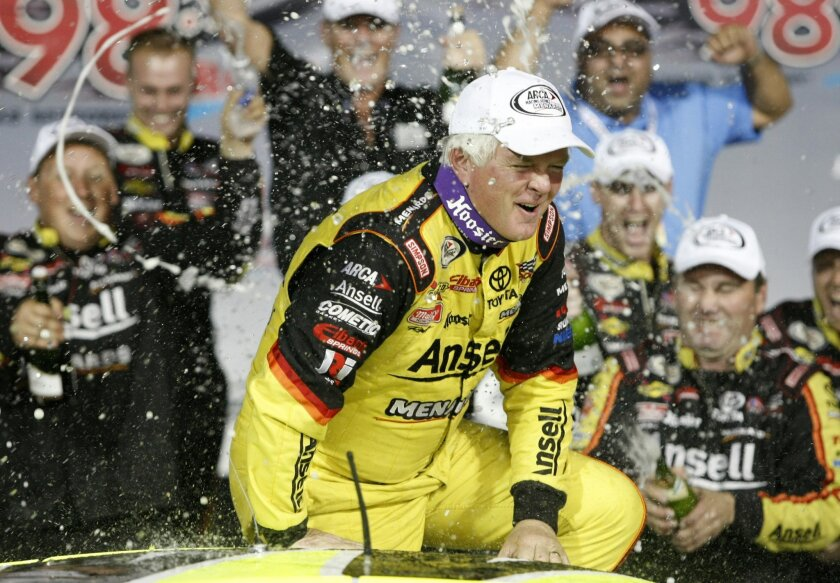 FILE- In this Oct. 4, 2013, file photo, driver Frank Kimmel is sprayed by his crew after winning an ARCA racing series auto race and the ARCA points championship at Kansas Speedway in Kansas City, Kan. Kimmel is set to become the second driver in the ARCA stock car series to make 500 career starts. (AP Photo/Colin E. Braley, File)