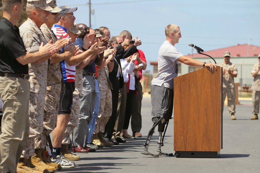 Rob Jones gets applause as he speaks at the celebration for him here at the Camp Del Mar area of the base.