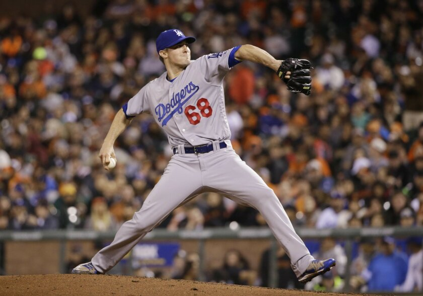 Los Angeles Dodgers starter Ross Stripling throws to the San Francisco Giants during the seventh inning of a baseball game Friday, April 8, 2016, in San Francisco. (AP Photo/Marcio Jose Sanchez)