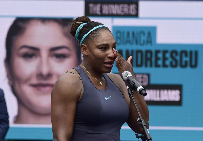 Serena Williams holds back tears while talking at the Rogers Cup.