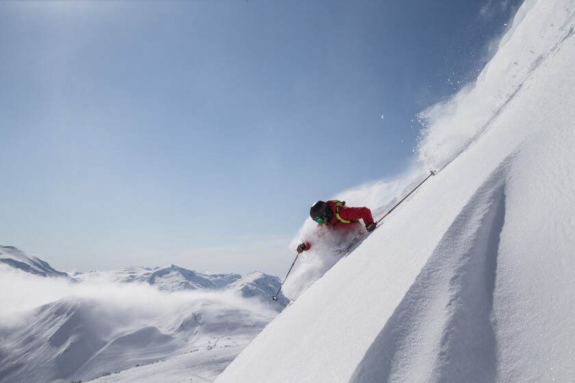 A skier flies down the Sun Bowl on Whistler Mountain in British Columbia, Canada.