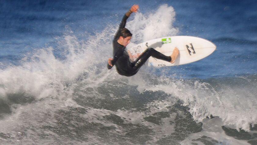 National junior surfing champion Ryland Rubens at Scripps Beach near the Scripps Pier in La Jolla.