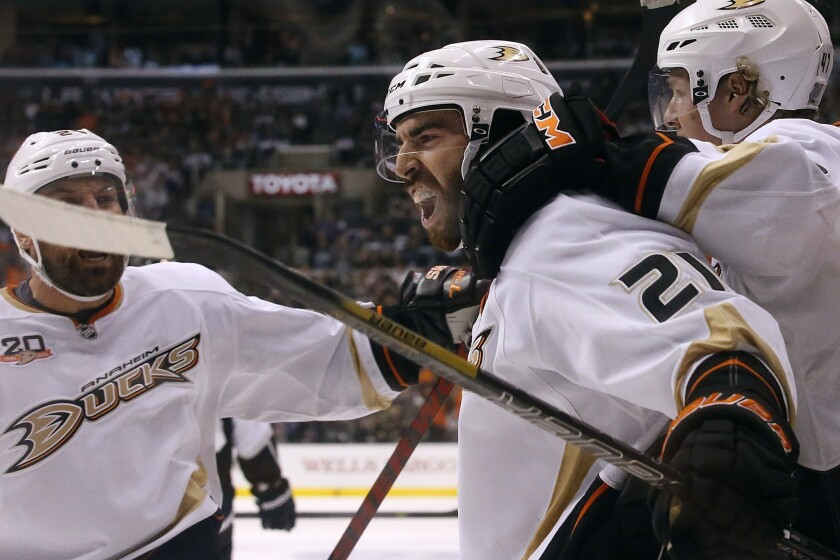 Ducks winger Kyle Palmieri celebrates with teammates after scoring against the Kings in the second period of Game 6. The Kings beats the Ducks, 2-1.
