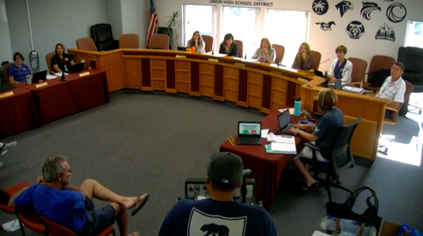 Classified employee Carlos Magana addresses the board on Aug. 22.