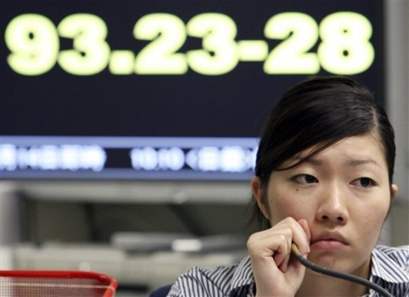 A currency dealer monitors the Tokyo Foreign Exchange Market in Tokyo, Thursday, July 9, 2009. In currencies, the dollar was trading at 93.23 yen Thursday morning. (AP Photo/Koji Sasahara)