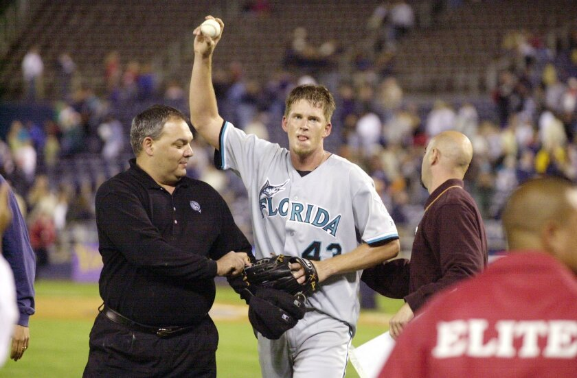 Marlins pitcher A. J. Burnett leaves the field after no-hitting the Padres, but with nine walks, in 2001. Jim Baird / Union-Tribune