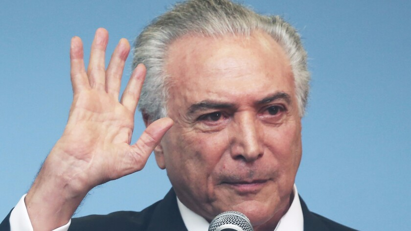 Brazil's interim President Michel Temer waves at an event inaugurating the new subway train which links the Ipanema and Barra da Tijuca neighborhoods on July 30, 2016, in Rio de Janeiro.