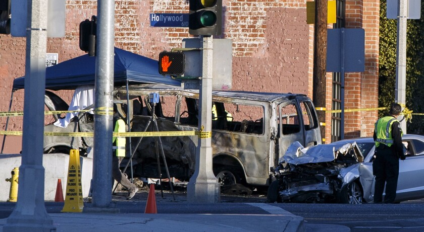 L.A. police officers investigate the scene of a fatal car accident at Hollywood Boulevard and Gower Street.