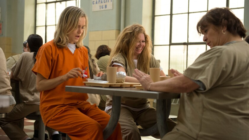 """Taylor Schilling, left, Natasha Lyonne, center, and Lin Tucci in Netflix's """"Orange is the New Black."""""""
