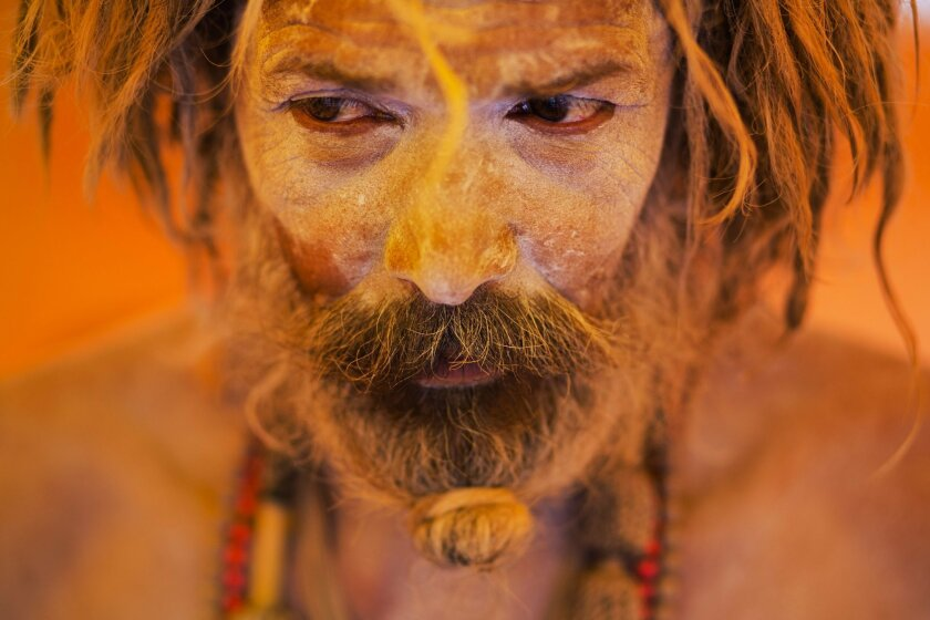In this Aug. 27, 2015 file photo, Naga sadhu, or naked Hindu holy man, pauses inside a tent during Kumbh Mela, or Pitcher festival, at Trimbakeshwar, India. Hindus believe taking a dip in the waters of a holy river during the festival will cleanse them of their sins. The festival is held four times every 12 years. (AP Photo/Bernat Armangue, File)