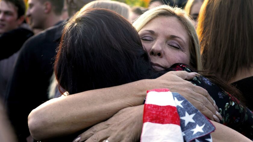 Thousand Oaks, CA November 17, 2018: Wearing am American flag on her wrist Laura Lynn Meek, right,