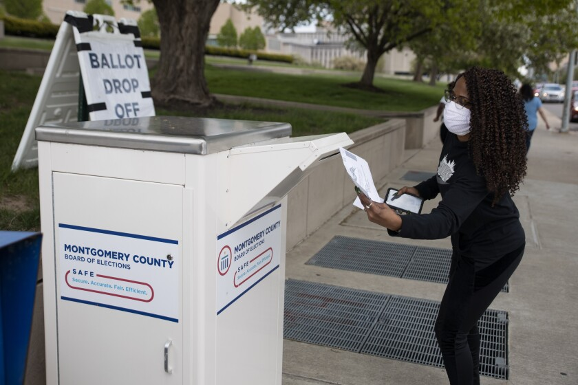 An Ohio voter drops off her ballot at the Board of Elections in Dayton, Ohio on April 28, 2020.