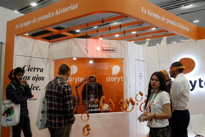 """General view of an audiobook booth of the company Storytel during the International Book Fair of Guadalajara (FIL), in Guadalajara, Mexico, 27 November 2018. Still incipient, the audiobook sector looks for a gap in the Latin American publishing scene, where there is a high number of potential readers but also obstacles to be overcome as the high cost of developing these products. For publishers, the incursion of audiobooks is """"a totally positive impact"""" because it translates into """"winning readers,"""" says Sergio Vilela, director of digital content for Latin America at Grupo Planeta. EPA/EFE/Francisco Guasco"""