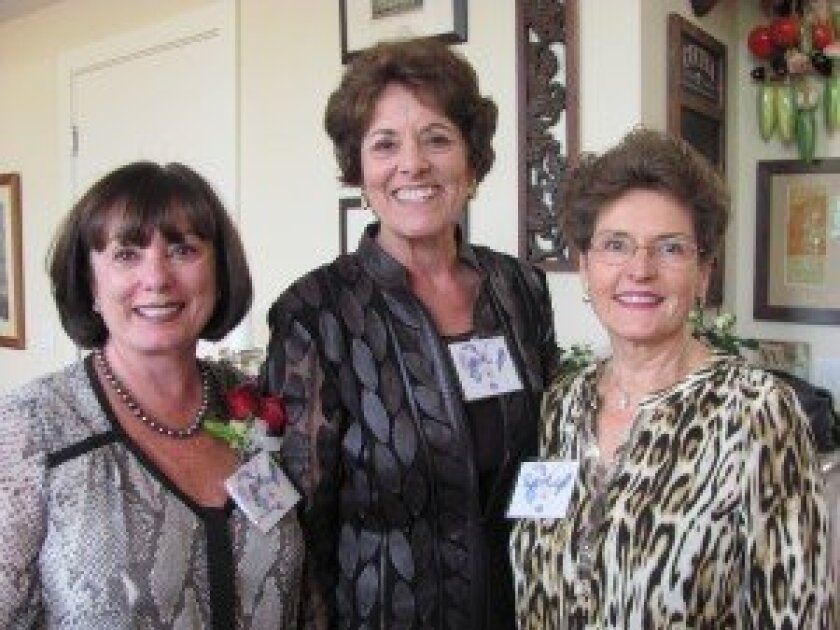 Chair of the Tea and an honoree, Carol Katz, with former Salvation Army Women's Auxiliary president Patty Moises and current president Karin Donaldson.