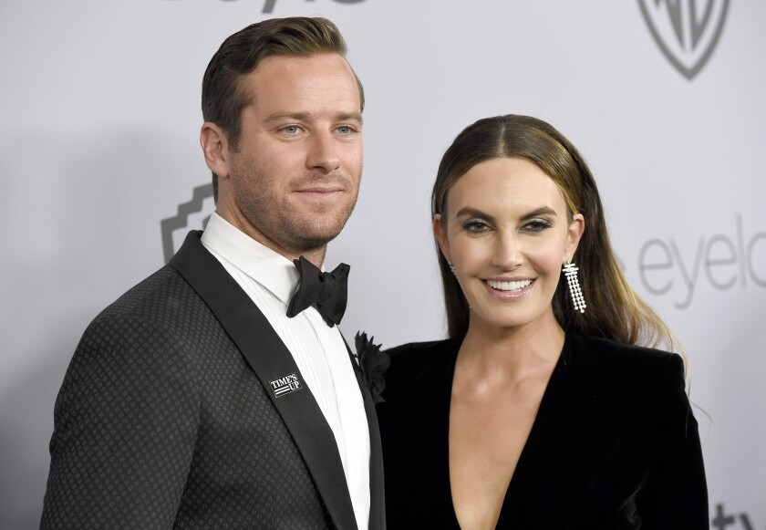 """FILE - In this Jan. 7, 2018, file photo, Armie Hammer, left, and Elizabeth Chambers arrive at the InStyle and Warner Bros. Golden Globes afterparty in Beverly Hills, Calif. The actor, known for his work in """"The Social Network"""" and """"Call Me By Your Name,"""" and his wife are splitting up after 10 years of marriage and 13 years together. The couple share a five-year-old daughter, Harper and a three-year-old son, Ford. (Photo by Chris Pizzello/Invision/AP, File)"""