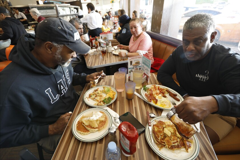 Eric Epperson, left, and Tony Jones enjoy breakfast at Norms in West Hollywood.