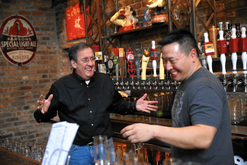 """Michael Roper, left, owner of Hopleaf, bar and restaurant talks Feb. 16, 2017, with bartender James Park at the tavern in Chicago's Andersonville neighborhood. On Inauguration Day, Roper dubbed Hopleaf a """"No Trump Zone"""" and donated the day's sales to Planned Parenthood."""
