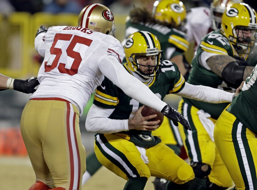 San Francisco 49ers outside linebacker Ahmad Brooks (55) sacks Green Bay Packers quarterback Aaron Rodgers (12) during the second half of an NFL wild-card playoff football game, Sunday, Jan. 5, 2014, in Green Bay, Wis. (AP Photo/Mike Roemer)