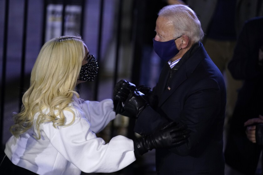 Lady Gaga pats Joe Biden on the arms at his final rally on Monday night in Pittsburgh.