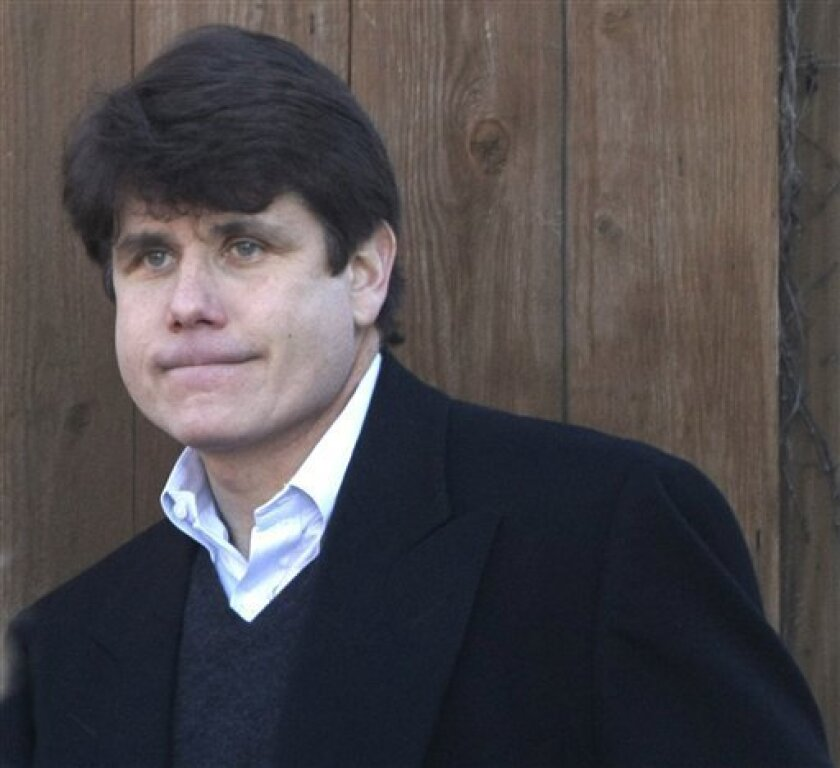 Illinois Gov. Rod Blagojevich departs his home in Chicago, Thursday, Dec. 11, 2008. (AP Photo/Charles Rex Arbogast)