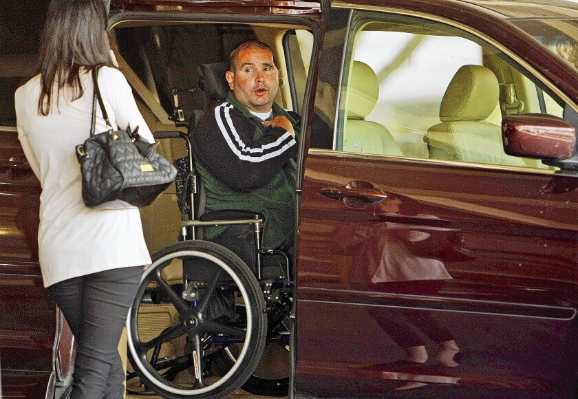 A wheelchair-bound Bryan Stow says goodbye to his sister Bonnie Stow, left, as he departs the Los Angeles County Superior courthouse in downtown L.A. on May 28.