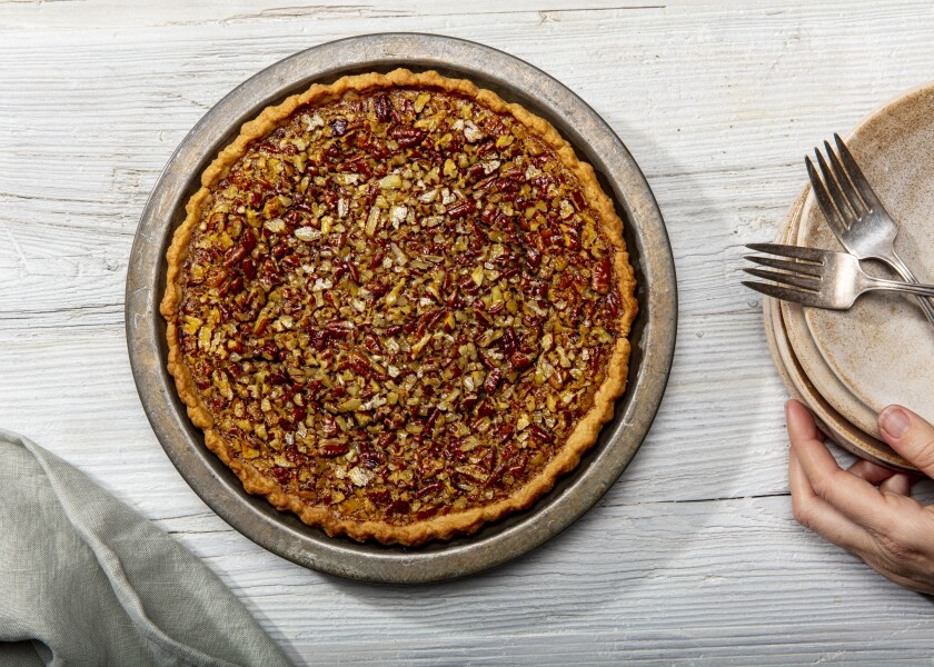 A pecan pie with hot water pastry.