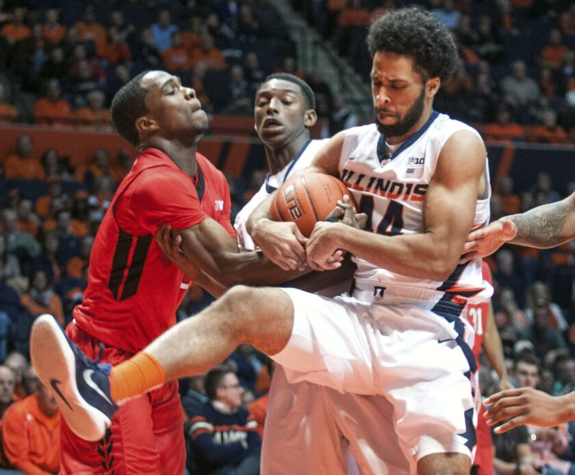 Illinois' guard Alex Austin (44) and Rutgers' guard Mike Williams (5) struggle over the ball as Illinois' guard Jalen Coleman-Lands (5) looks on in the second half of the NCAA college basketball game at State Farm Center in Champaign, Ill on Tuesday, Feb. 16, 2016.  Illinois won 82-66. (AP Photo/He