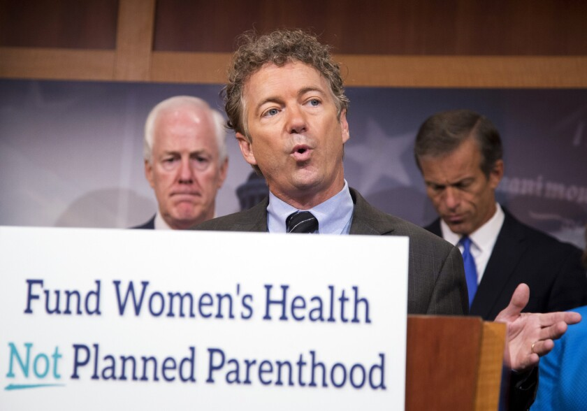 Sen. Rand Paul (R-Ky.), center, with Sens. John Cornyn (R-Texas), left, and John Thune (R-S.D.) speaks about Planned Parenthood in Washington last week.
