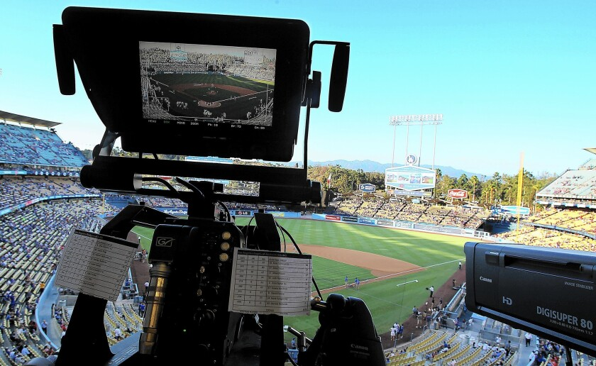 A TV camera is trained on the field at Dodger Stadium for the game between the Dodgers and Angels. Most fans in the region have been unable to tune into Dodgers games this season because they don't get service from Time Warner Cable.