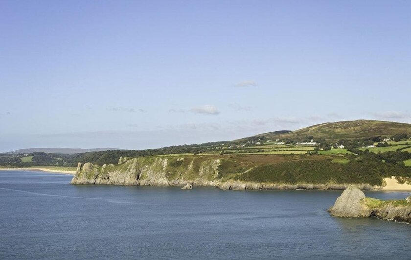 View past Pobbles bay and Three Cliffs Bay towards Great Tor from the east of the Gower Peninsula. Swansea County.