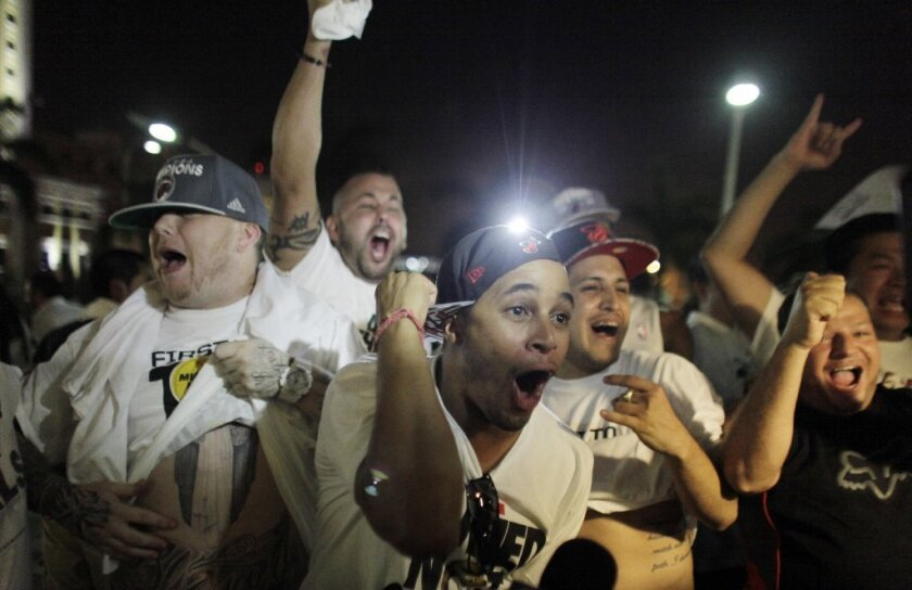 Heat fans gather outside the arena to celebrate Miami's Game 6 victory.