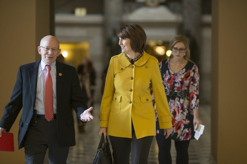 Rep. Cathy McMorris Rodgers, R-Wash., center, walks to the House chamber on Capitol Hill in Washington, Friday, Feb. 12, 2016, with Rep. Peter DeFazio, R-Ore., left, as the House votes to approve her bill to give supermarkets, fast-food chains and other businesses some relief from calorie labeling