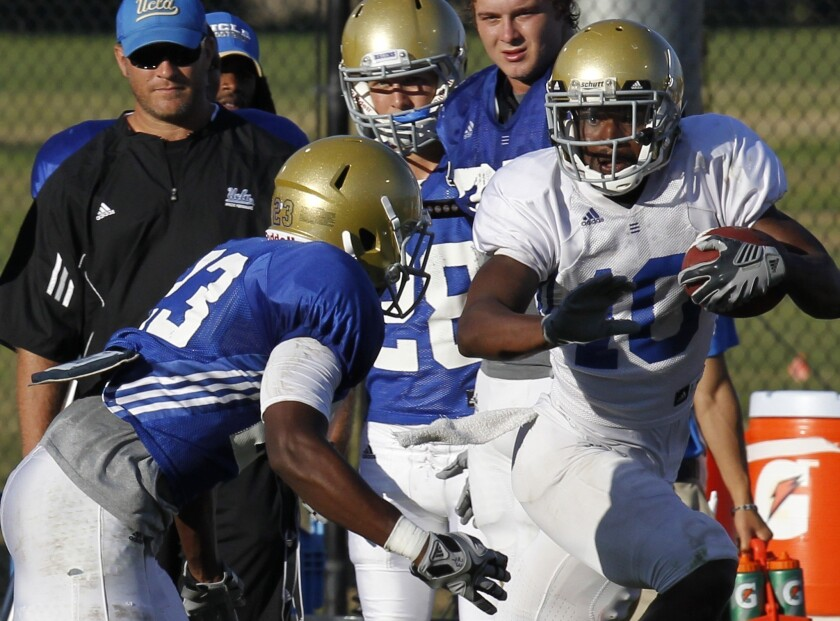 Former UCLA receiver Ricky Marvray, shown during the Bruins' fall scrimmage in 2011, will graduate this spring.