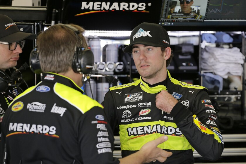 Ryan Blaney, right, talks with crew members in his garage during a practice session for the NASCAR Daytona 500 auto race at Daytona International Speedway, Saturday, Feb. 15, 2020, in Daytona Beach, Fla. (AP Photo/Terry Renna)