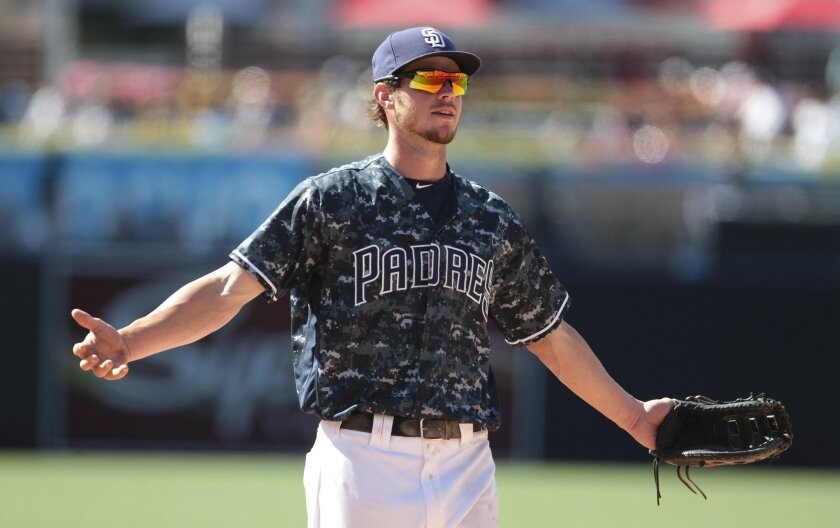 The Padres' Wil Myers gestures toward fans after he threw them a baseball in the ninth inning of the Padres' game against the Yankees at Petco Park in San Diego on Sunday, July 3, 2016.