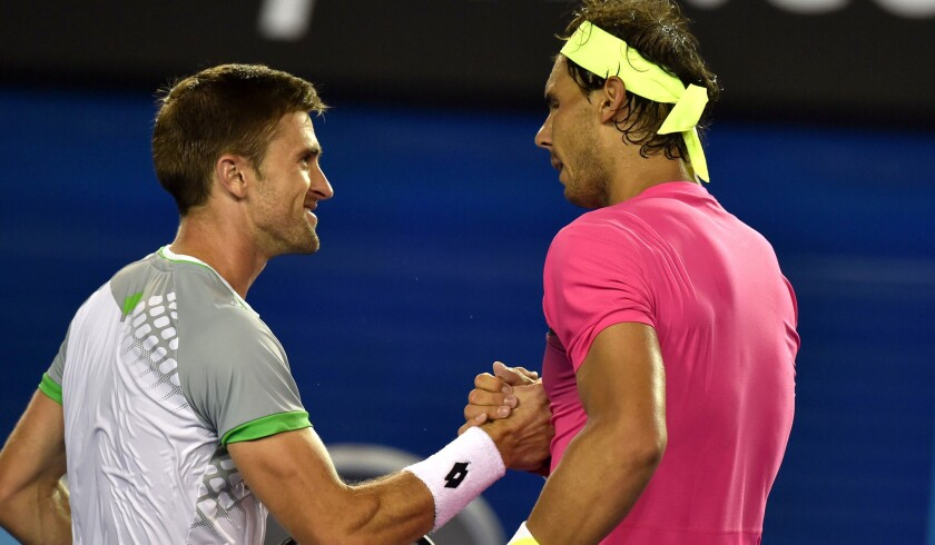 Tim Smyczek shakes hands with Rafael Nadal after their match at the Australian Open on Jan. 21.
