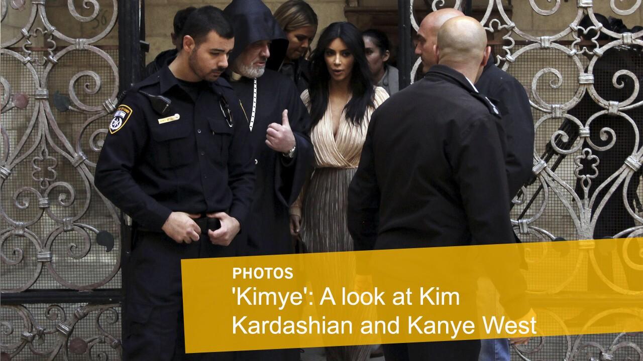 Kim Kardashian walks inside Armenian St. James Cathedral in Jerusalem with husband Kanye West, their daughter, North, and sister Khloe Kardashian.
