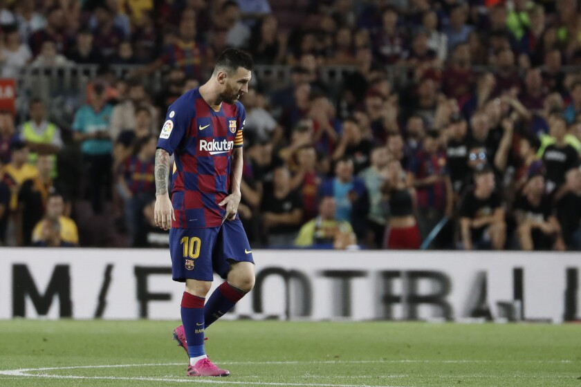 Barcelona's Lionel Messi walks on the pitch after getting hurt during the Spanish La Liga soccer match between FC Barcelona and Villarreal CF at the Camp Nou stadium in Barcelona, Spain, Tuesday, Sep. 24, 2019. (AP Photo/Joan Monfort)