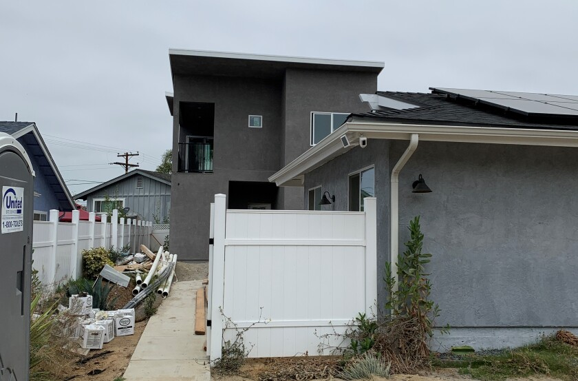 A two-story addition in the backyard of a single-story home has residents in University City concerned.