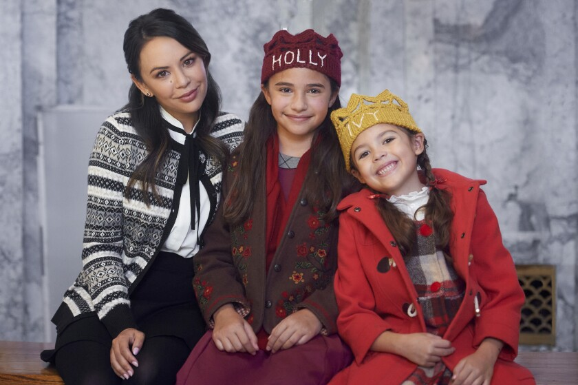 "Sadie Coleman (center) stars in ""Holly & Ivy"" with Janel Parrish and Piper Rubio."