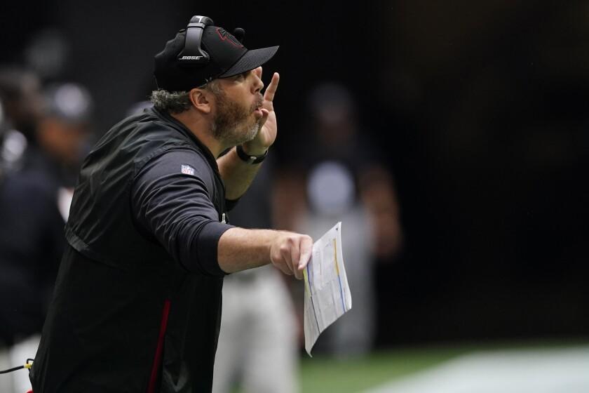 Atlanta Falcons head coach Arthur Smith speaks to players during the second half of an NFL football game against the Washington Football Team, Sunday, Oct. 3, 2021, in Atlanta. (AP Photo/John Bazemore)