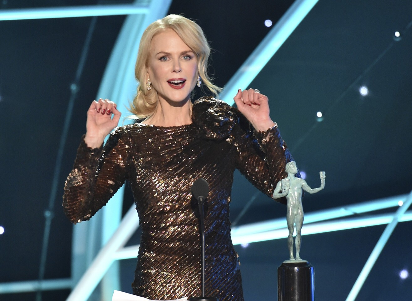 """Nicole Kidman accepts the award for outstanding performance by a female actor in a television movie or limited series for """"Big Little Lies"""" at the 24th annual Screen Actors Guild Awards at the Shrine Auditorium & Expo Hall on Sunday, Jan. 21, 2018, in Los Angeles. (Photo by Vince Bucci/Invision/AP)"""