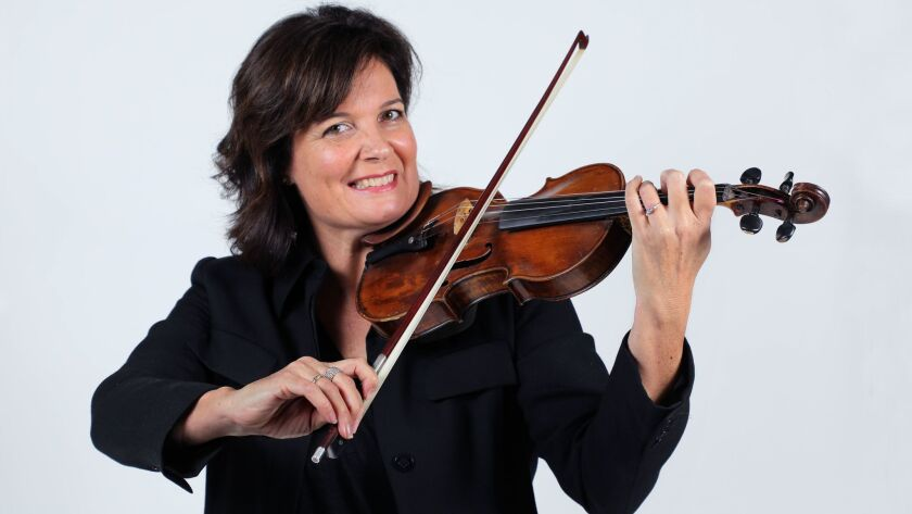 Victoria Eicher with her Kempter violin that was made in 1776. She is the director of the City Heights Music School, and president and executive director of the Youth Philharmonic Orchestra.