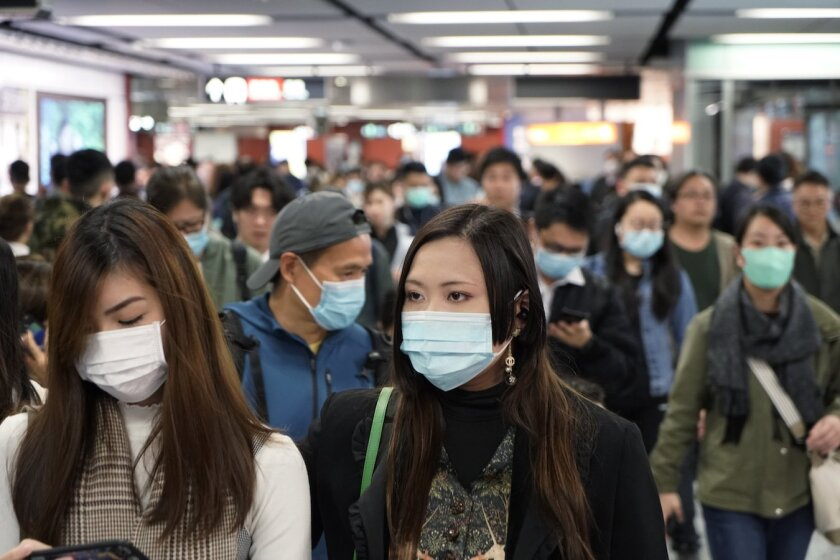 Subway passengers in Hong Kong wear masks to prevent the spread of the deadly coronavirus. The city has eight confirmed cases of the disease.