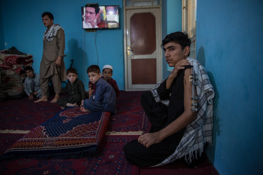 Naveed Nazari, 19, was shot in the left arm when the Taliban attacked his checkpoint on the outskirts of Kunduz city.