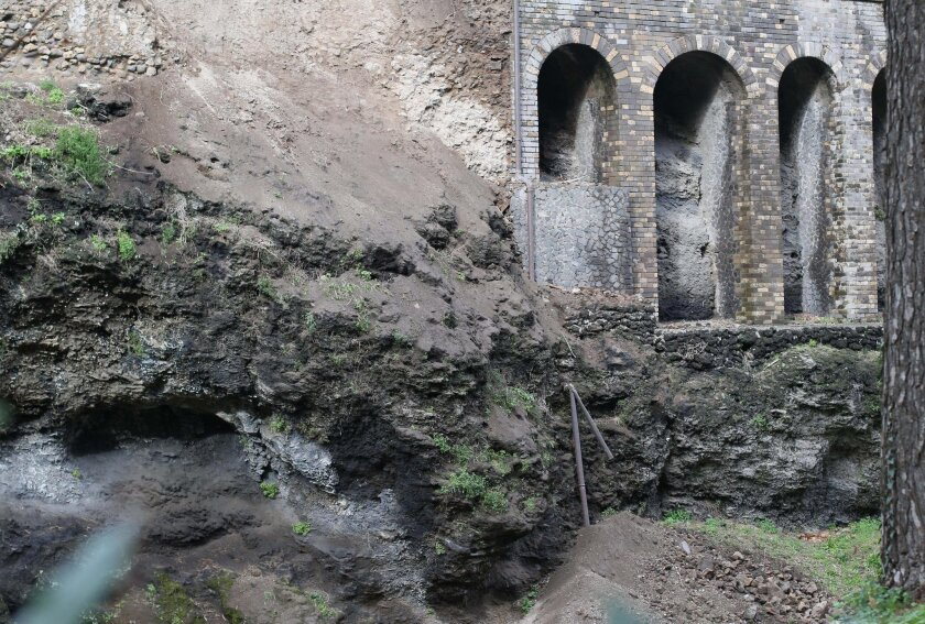 A landslide due to heavy rains is seen in the ancient site of Pompeii, Italy, Wednesday, Feb. 4, 2015. The ancient site of Pompeii has suffered a landslide due to heavy rains, causing a retaining wall and garden at the house of Severus to partially collapse. Officials on Wednesday said the area aff