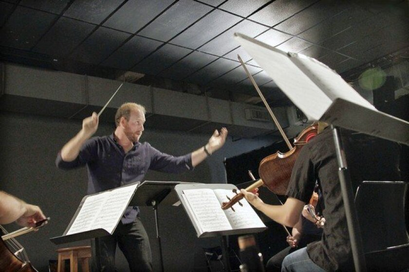 Wild Up ensemble music director Christopher Rountree conducts during rehearsal at the Hammer Museum on July 12, 2012.
