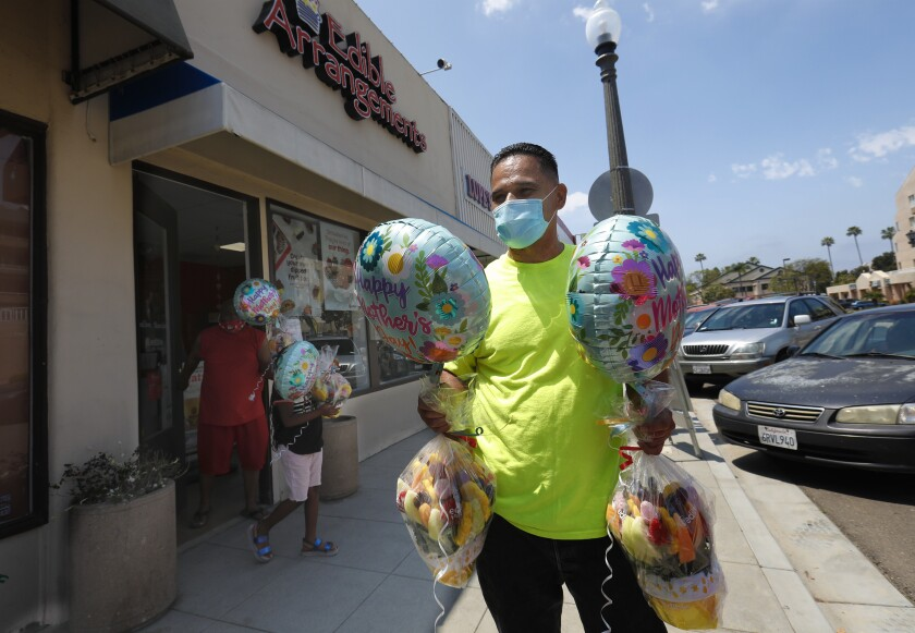 Nolan Kennedy picked up fruit from Edibles Arrangements in La Mesa for Mother's Day.