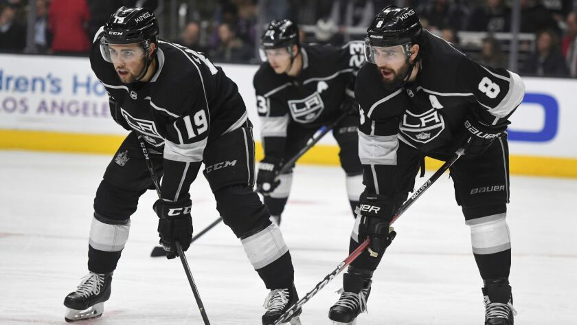 Kings center Alex Iafallo (19), right wing Dustin Brown (23), and defenseman Drew Doughty (8) line up for a faceoff during a game against the New York Rangers on Sunday.